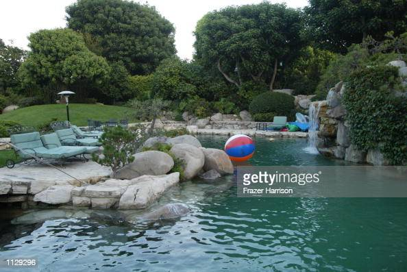 The Playboy grotto and pool pictured at the Parrots in Paradise benefit at the Playboy Mansion June 27 2002 in Beverly Hills California The benefit...