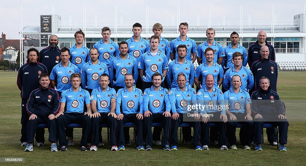 The players and coaches of Northamptonshire CCC line up for a team photograph wearing the T20 kit during the pre-season photocall held at the County Ground on April 3, 2013 in Northampton, England.