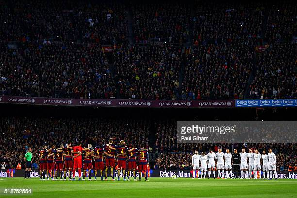 The players and fans observe a minute's silence in memory of the former FC Barcelona player and manager Johan Cruyff before the La Liga match between...