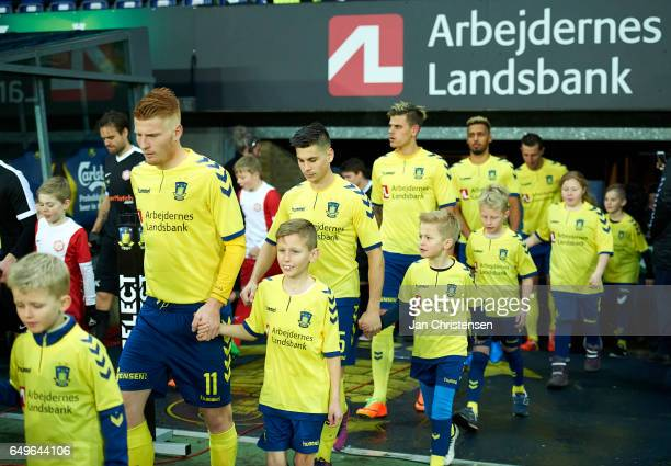 The players and mascots walk on to the pitch prior to the Danish Cup DBU Pokalen match between BK Marienlyst and Brondby IF at Brondby Stadion on...