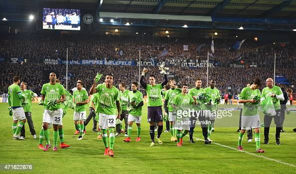 The players and staff of Wolfsburg celebrate after winning the DFB Cup semi final match between Arminia Bielefeld and VfL Wolfsburg at Schueco Arena...