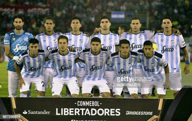 The players Atletico Tucuman of Argentina pose before their Copa Libertadores football match against Bolivia's Wilstermannt at Felix Capriles Stadium...