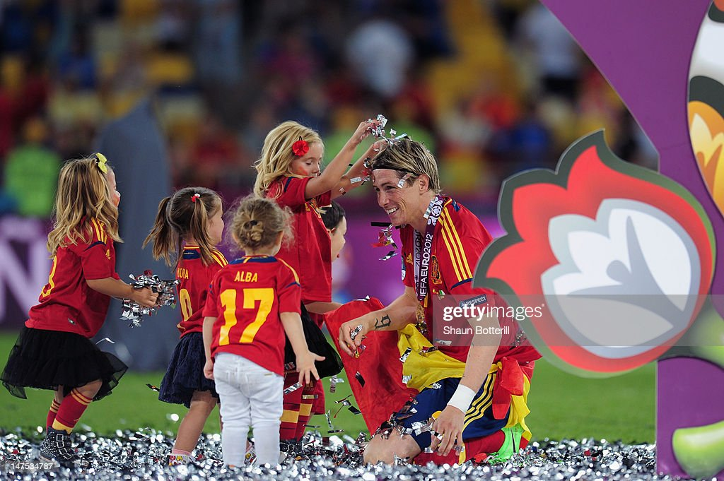 The players' children play in the confetti with <a gi-track='captionPersonalityLinkClicked' href=/galleries/search?phrase=Fernando+Torres&family=editorial&specificpeople=194755 ng-click='$event.stopPropagation()'>Fernando Torres</a> during the UEFA EURO 2012 final match between Spain and Italy at the Olympic Stadium on July 1, 2012 in Kiev, Ukraine.