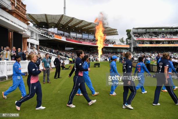 The players come onto the pitch before the ICC Women's World Cup 2017 Final between England and India at Lord's Cricket Ground on July 23 2017 in...
