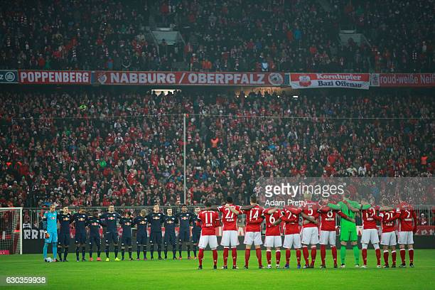 The players fans and officlas observe a minute's silence to remember the victims of the Berlin attack during the Bundesliga match between Bayern...