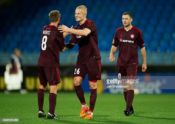 The players from AaB Aalborg celebrate after the UEFA Europa Liga match between AaB Aalborg and Rio Ave FC at Nordjyske Arena on Oktober 02 2014 in...