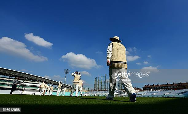 The players make their way onto the pitch for the start of play during day one of the preseason friendly between Surrey and Middlesex at The Kia Oval...