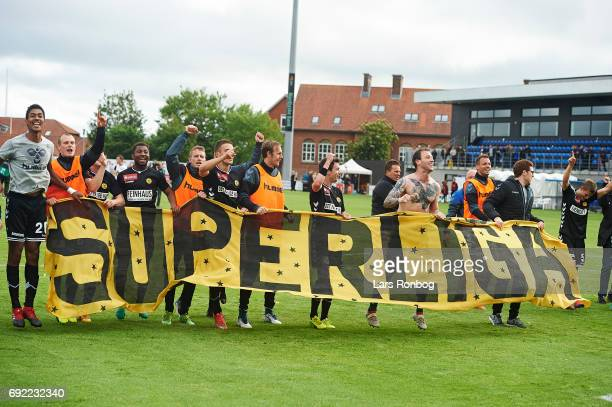 The players of AC Horsens celebrate after the Danish Alka Superliga Playoff match between Vendsyssel FF and AC Horsens at Bredband Nord Arena on June...