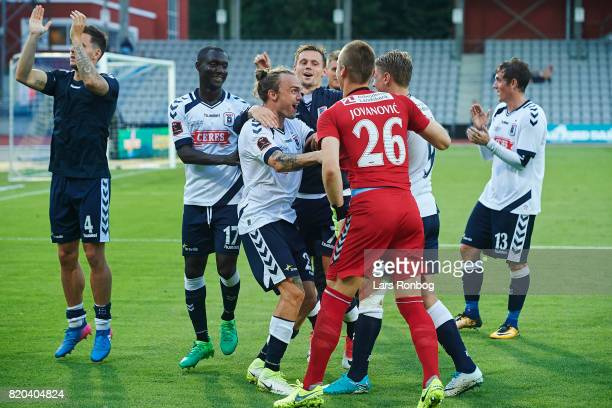 The players of AGF Aarhus Adama Guira Pierre Kanstrup and Aleksandar Jovanovic celebrate after the Danish Alka Superliga match between AGF Aarhus and...