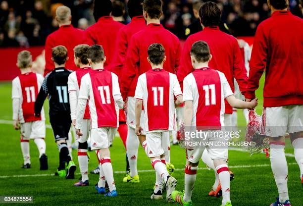 The players of Ajax Amsterdam pay tribute to the recently died Ajax' football player Piet Keizer prior to the Dutch Eredivisie football match against...