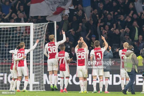 The players of Ajax celebrates after wining during the UEFA Europa League Quarter Final first leg match between Ajax Amsterdam and FC Schalke 04 at...