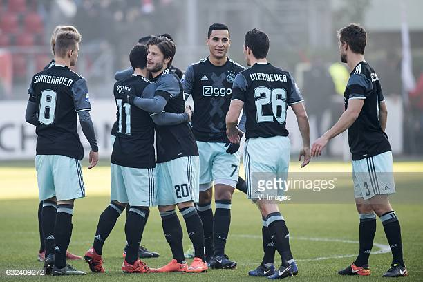 the players of Ajax wish eachother good luck at the start of the match Daley Sinkgraven of Ajax Amin Younes of Ajax Lasse Schone of Ajax Anwar el...