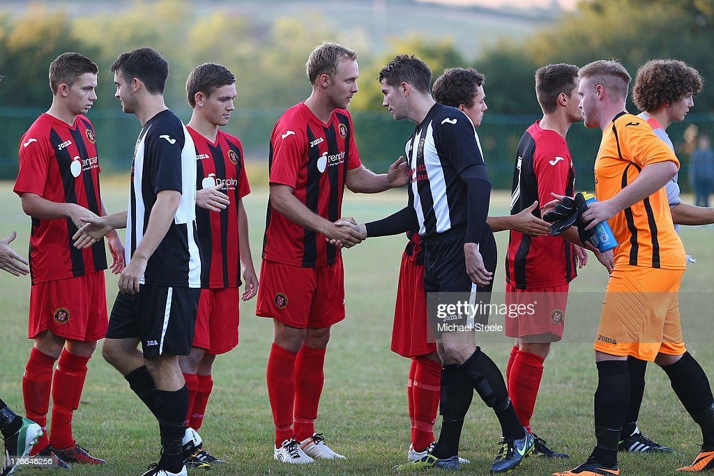 The players of Alresford Town of Winchester City shake hands prior to the FA Cup Extra Preliminary Round match between Alresford Town and Winchester City at Alrebury Park on August 16, 2013 in New Alresford, England.