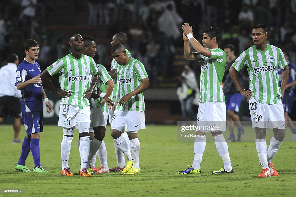 The players of Atletico Nacional leave the field with a defeat at the end of a quarterfinal match between Atletico Nacional and Defensor Sporting as part of Copa Bridgestone Libertadores 2014 at Atanasio Girardot Stadium on May 08, 2014 in Medellin, Colombia.