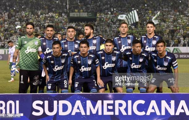 The players of Atletico Tucuman of Agentina pose before their Sudamericana Cup football match against Oriente Petrolero of Bolivia at the Ramon...
