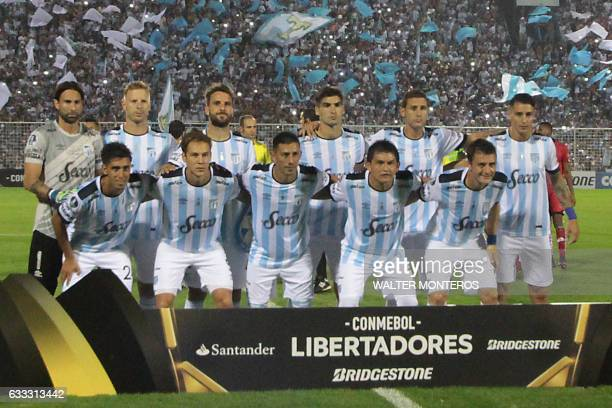 The players of Atletico Tucuman pose before the start of their Libertadores Cup football match against El National de Quito in San Miguel de Tucuman...