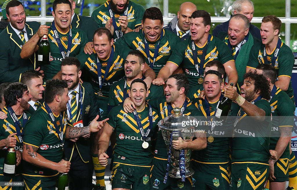 The players of Australia celebrate with the Rugby League World Cup after victory over New Zealand in the Rugby League World Cup Final between New...