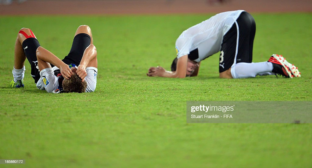 The players of Austria look dejected at the end of the FIFA U 17 World Cup group E match between Austria and Iran at Khalifa Bin Zayed Stadium on October 25, 2013 in Al Ain, United Arab Emirates.