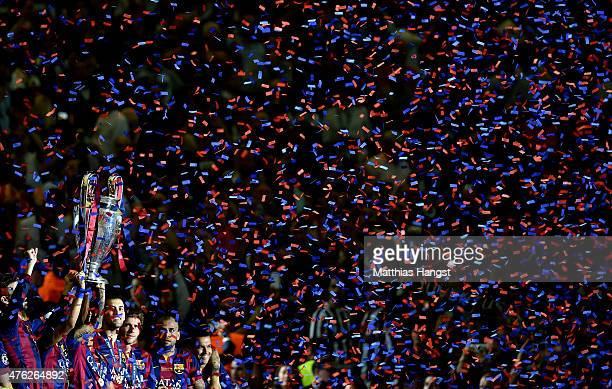 The players of Barcelona lift the trophy as they celebrate victory after the UEFA Champions League Final between Juventus and FC Barcelona at...