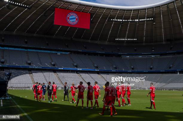 The players of Bayern Munich leaving the pitch after the team photo session of FC Bayern Munich in the southern German city of Munich on August 8...