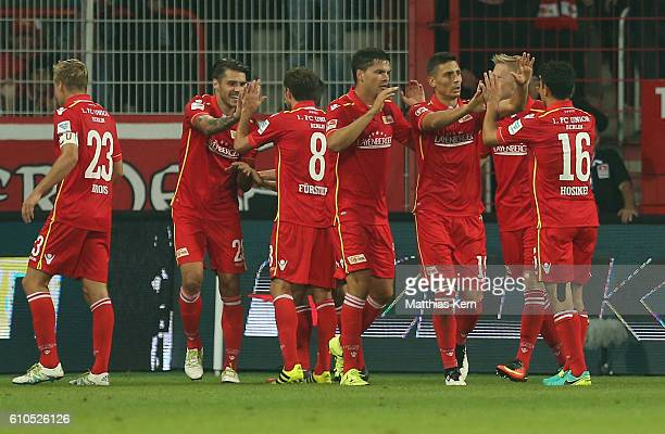 The players of Berlin celebrate after team mate Kenny Prince Redondo scoring the second goal during the Second Bundesliga match between 1 FC Union...