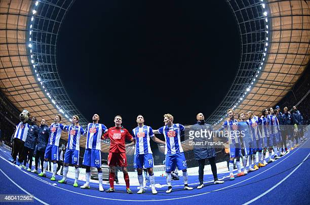 The players of Berlin celebrate at the end of the Bundesliga match between Hertha BSC and Borussia Dortmund at Olympiastadion on December 13 2014 in...