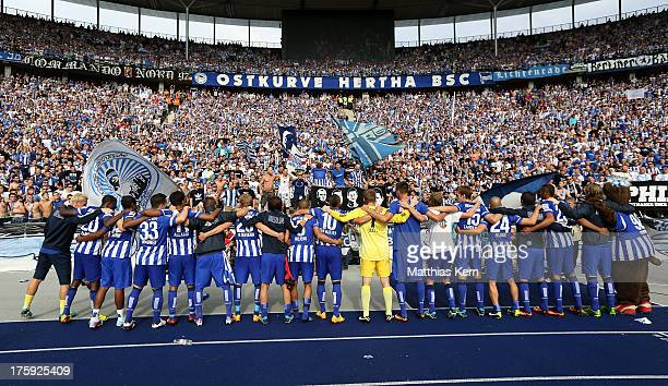 The players of Berlin celebrate with their supporters after winning the Bundesliga match between Hertha BSC Berlin and Eintracht Frankfurt at...