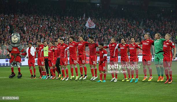 The players of Berlin celebrate with their supporters after winning the Second Bundesliga match between 1 FC Union Berlin and FC St Pauli at Stadion...