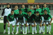 The players of Bolivia line up prior to the international friendly match between Latvia and Bolivia at Mardan Sports Complex stadium on February 9...