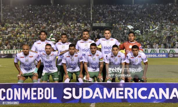 The players of Bolivian Oriente Petrolero pose before their Sudamericana Cup football match against Argentinian Atletico Tucuman at the Ramon...