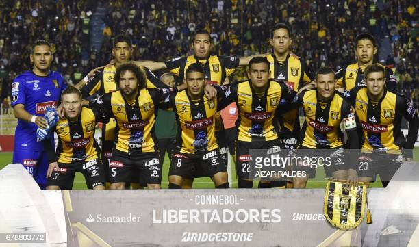 The players of Bolivia's The Strongest pose before their Copa Libertadores football match against Peru's Sporting Cristal at Hernando Siles Stadium...