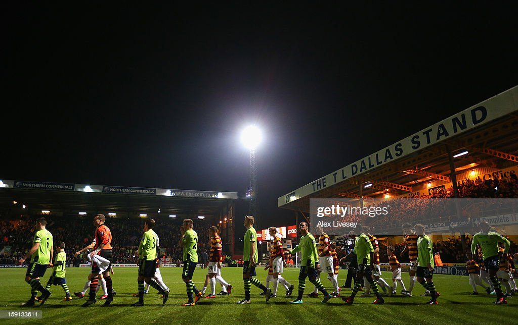 The players of Bradford City and Aston Villa walk on to the pitch prior to the Capital One Cup Semi-Final 1st Leg match between Bradford City and Aston Villa at Coral Windows Stadium, Valley Parade on January 8, 2013 in Bradford, England.