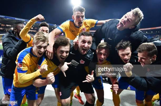 The players of Braunschweig celebrate at the end of the Second Bundesliga match between Eintracht Braunschweig and 1 FC Heidenheim 1846 at Eintracht...