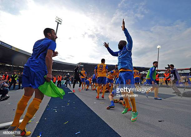 The players of Braunschweig celebrate with their fans at the end of the Bundesliga match between Eintracht Braunschweig and Hannover 96 at Eintracht...