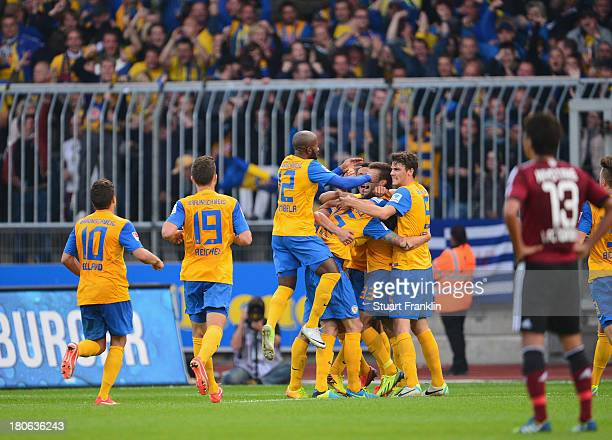 The players of Braunschweig celebretae their goal during the Bundesliga match between Eintracht Braunschweig and 1 FC Nuernberg at Eintracht Stadion...