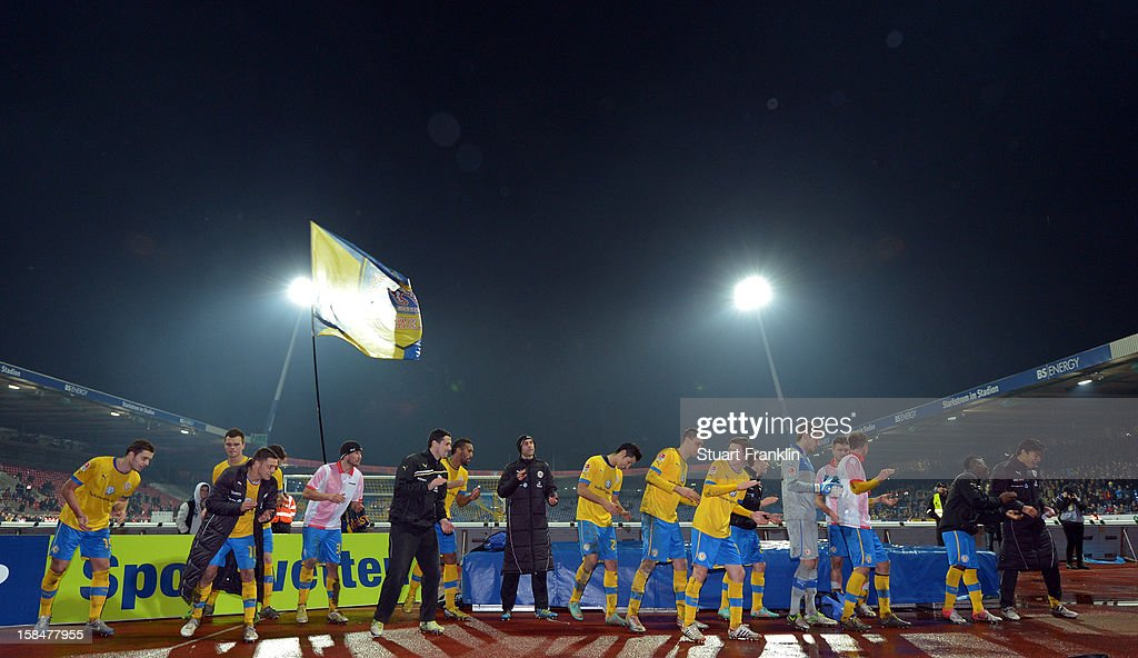 The players of Braunschweig dance before the fans at the end of the Second Bundesliga match between Eintracht Braunschweig and1. FC Union Berlin at the eintracht stadium on December 17, 2012 in Braunschweig, Germany.