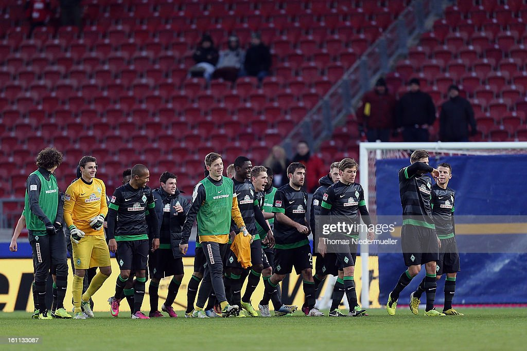 The players of Bremen celebrate after the Bundesliga match between VfB Stuttgart and Werder Bremen at Mercedes-Benz Arena on February 9, 2013 in Stuttgart, Germany.