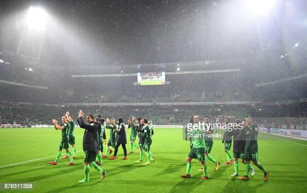 The players of Bremen celebrate after the Bundesliga match between SV Werder Bremen and Hannover 96 at Weserstadion on November 19 2017 in Bremen...