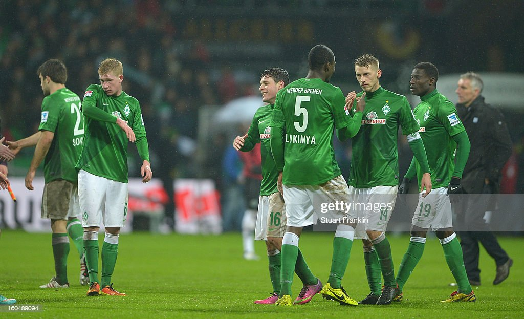 The players of Bremen celebrate at the end of the Bundesliga match between SV Werder Bremen and Hannover 96 at Weser Stadium on February 1, 2013 in Bremen, Germany.