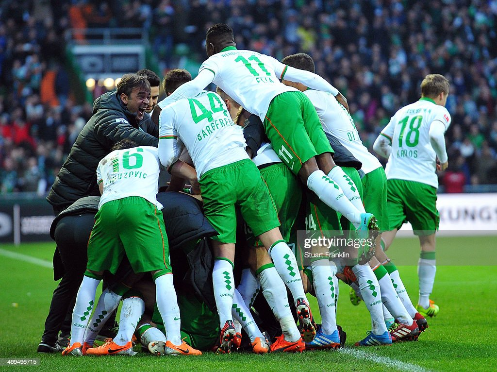 The players of Bremen celebrate their teams goal during the Bundesliga match between Werder Bremen and Borussia Moenchengladbach at Weserstadion on February 15, 2014 in Bremen, Germany.