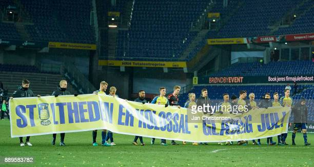 The players of Brondby IF celebrating the team spirit of Brondby IF with a banner after the Danish Alka Superliga match between Brondby IF and AGF...
