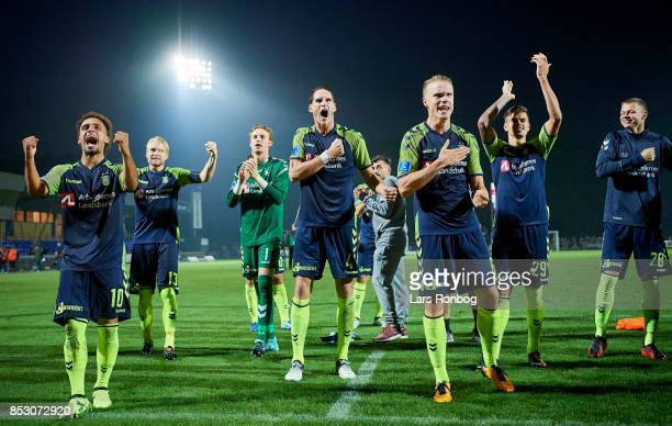 The players of Brondby IF Hany Mukhtar Benedikt Rocker Hjortur Hermannsson celebrate after the Danish Alka Superliga match between Hobro IK and...