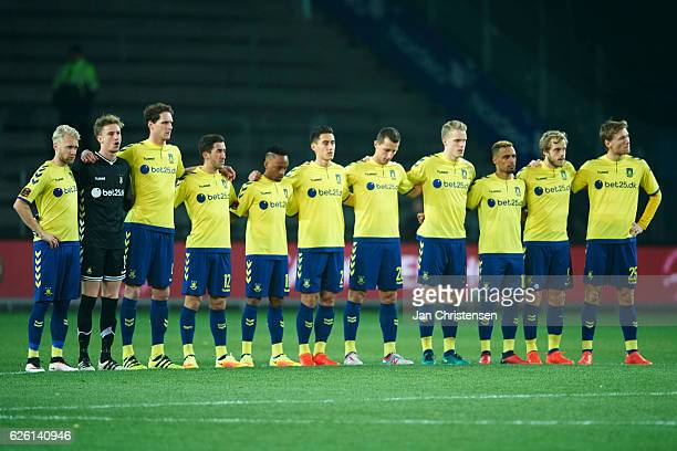 The players of Brondby IF hold one silent minute prior to the Danish Alka Superliga match between Brondby IF and Silkeborg IF at Brondby Stadion on...
