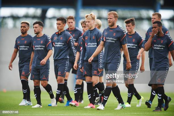 The players of Brondby walking on to the pitch during the Brondby IF training session at Brondby Stadion on June 20 2017 in Brondby Denmark
