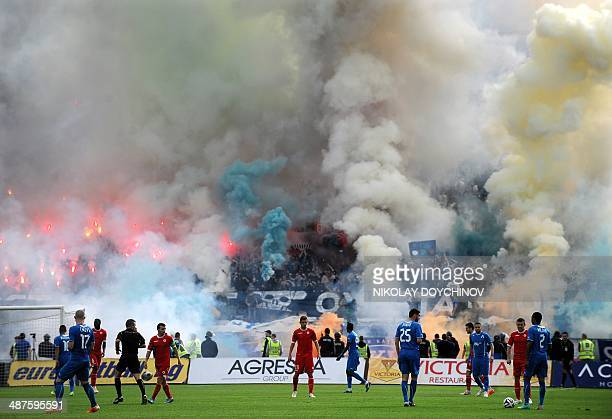 The players of CSKA Sofia and Levski Sofia are seen on the pitch during their Bulgarian football championship match in Sofia on April 21 2014 AFP...