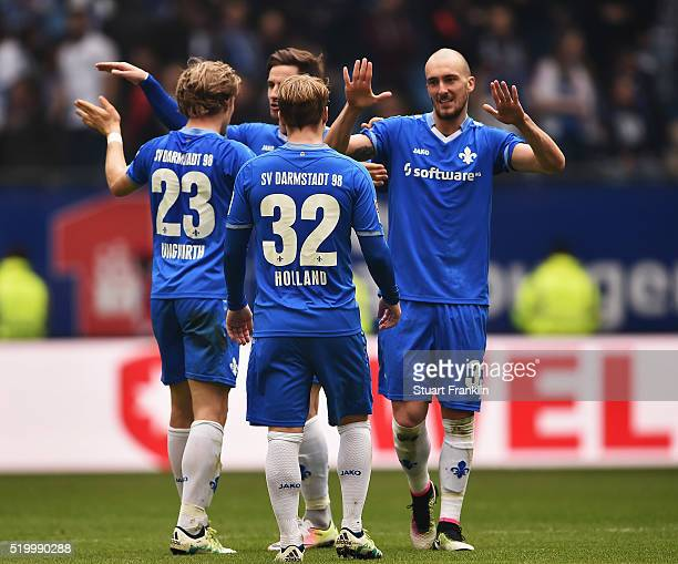 The players of Darmstadt celebrate at the end of the Bundesliga match between Hamburger SV and SV Darmstadt 98 at Volksparkstadion on April 9 2016 in...