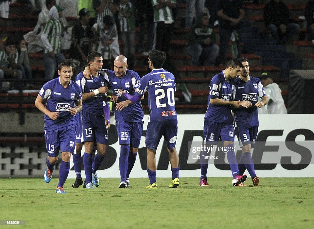 The players of Defensor Sporting celebrate the first goal of his team during a quarterfinal match between Atletico Nacional and Defensor Sporting as part of Copa Bridgestone Libertadores 2014 at Atanasio Girardot Stadium on May 08, 2014 in Medellin, Colombia.