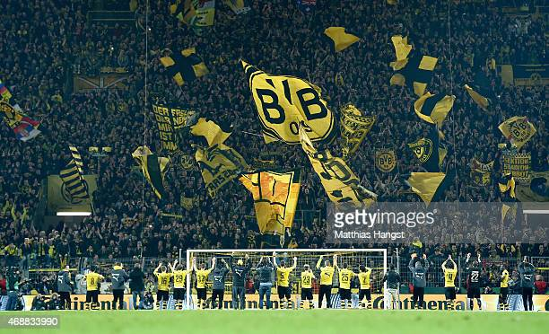 The players of Dortmund celebrate with the fans after the DFB Cup Quarter Final match between Borussia Dortmund and 1899 Hoffenheim at Signal Iduna...