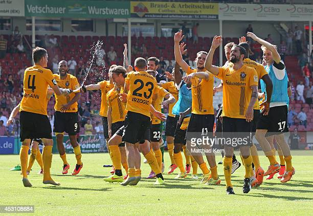 The players of Dresden celebrate after winning the third league match between FC Energie Cottbus and SG Dynamo Dresden at Stadion der Freundschaft on...