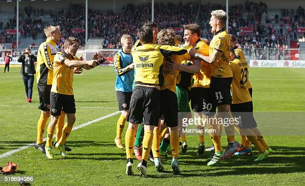 The players of Dresden celebrate with their supporters after winning the third league match between FC Energie Cottbus and SG Dynamo Dresden at...